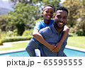 African American man and his son enjoying their time at a garden 65595555