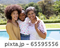 Multi-generation mixed race family enjoying their time at a garden 65595556