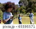 Volunteer mixed race woman enjoying her time outside 65595571