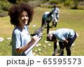 Volunteer mixed race woman enjoying her time outside 65595573
