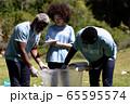 Volunteer mixed race family enjoying her time outside 65595574