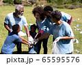 Volunteer mixed race family enjoying her time outside 65595576