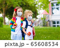 Kids on first school day in face mask 65608534
