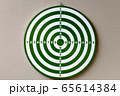 Portrait of dartboard with numbers against concrete wall 65614384