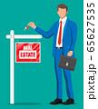 Businessman or realtor holding key. 65627535