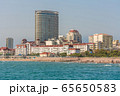 Traditional waterfront buildings and beach 65650583