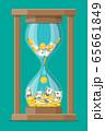 Money with hourglass clock. 65661849