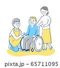 男性介護スタッフと車椅子のシニア男性と妻 65711095