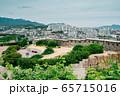 Naksan Park fortress wall road and Seoul cityscape in Seoul, Korea 65715016
