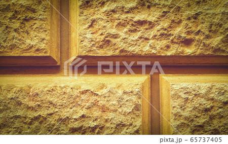 Textured background of decorative stone bricks 65737405