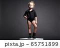 Beautiful little model girl. Funny child. 65751899