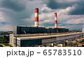 Aerial view of a power plant on cloudy sky background 65783510