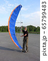 Man training in roller skating with kite 65799483