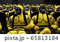 People in yellow protective suits sit in a movie theater waiting for a movie. People in a bacteriological protection suit and a gas mask. 3D Rendering. 65813184