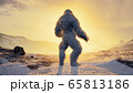 Sasquatch in the snowy mountains on a beautiful fog winter morning. Bigfoot in the mountains. Illustration for fabulous, fiction or fantasy backgrounds. 3D Rendering. 65813186
