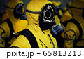 Medics in yellow protective suits lined up before the start of the working day. People in a bacteriological protection suit and a gas mask. 3D Rendering. 65813213