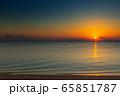 sunrise on sand beach 65851787
