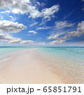 white sandy sea spit beach leading into ocean 65851791