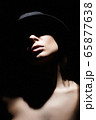 Beautiful woman in hat. Girl with face under 65877638
