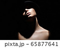 Beautiful woman in hat. Girl with face under 65877641