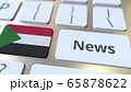News text and flag of Sudan on the keys of a computer keyboard. National online media related conceptual 3D rendering 65878622