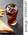 Glass of cola, club sandwich and potato fries 65900167