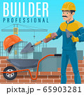 Builder laying a bricks on construction site 65903281