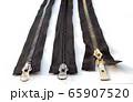 three metal closed zippers closeup 65907520