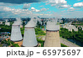 Aerial view of a thermal power plant cooling towers and cityscape of Moscow, Russia 65975697