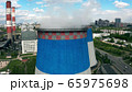 Aerial shot of steaming cooling towers of a thermal power plant 65975698