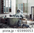 astronaut resting at home in the bath 65990053