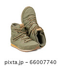 Comfortable trekking boots. Khaki green color warm shoes with lacing. Hiking concept. Cut out on white background.. 66007740