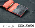 Red and black leather wallet on a black 66015059