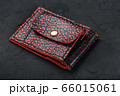 Red and black leather wallet on a black 66015061