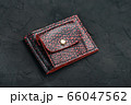 Red and black leather wallet on a black 66047562