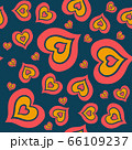 The seamless pattern consists of many multi-colored hearts embedded in each other on a dark blue background 66109237