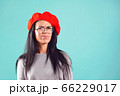 stylish woman in red beret frowned at camera 66229017