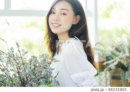 A Beautiful woman in flowers shop 66235803