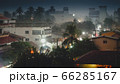 Tropical seasonal rains going at night over asian city on exotic island 66285167