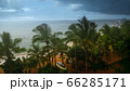 Image of heavy tropical rain storm and strong wind over exotic island in indian ocean. Typhoon and natural disaster 66285171