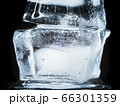 Ice Melts and Rotates on a Black Background. 66301359