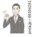 ガッツポーズする男性 66304291