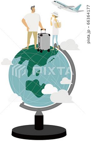 地球儀の上でキャリーケースを持つ男女 66364177