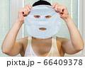 Woman Skin Care.Woman holding beauty mask 66409378