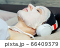 Closeup Of woman relaxing with Cosmetic Beauty Mask.Woman Skin Care concept 66409379