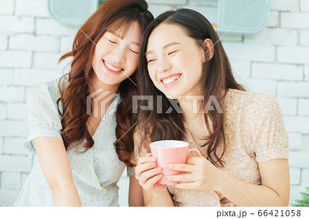 Two woman doing exercise at home 66421058