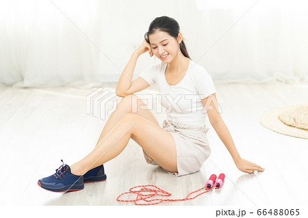 Beautiful woman doing exercise at home 66488065