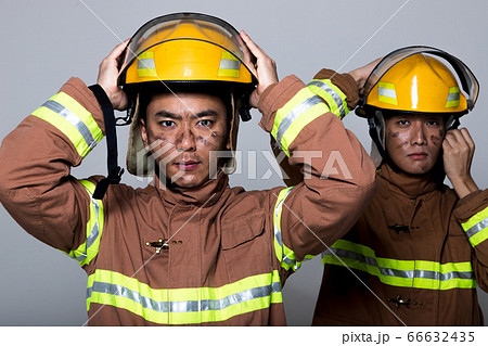 Asian male and female firefighter portrait, young smiling fireman in uniform 437 66632435
