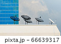 Satellite dish on top of a tall building 66639317