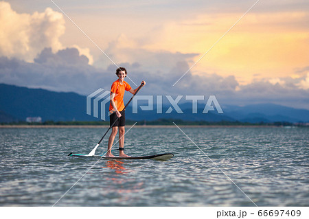 Man on stand up paddle. Water and beach sport 66697409